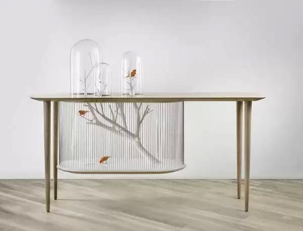 Совмещенный с птичьей клеткой обеденный стол от Gregoire de Laforrest для тех, кто действительно любит пернатых
