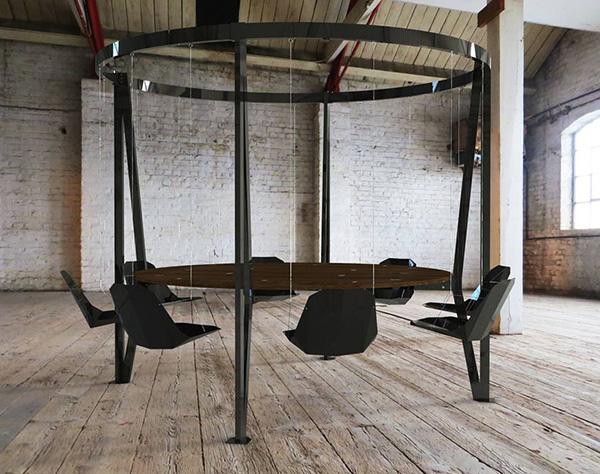 Необычный стальной стол с качелями.